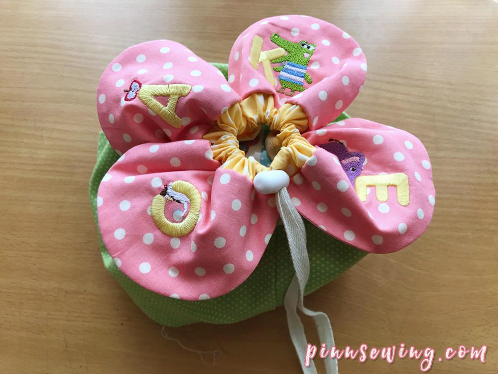 กระเป๋าปากรูดกลีบดอกไม้
